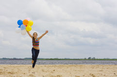 Young girl with balloons Stock Images
