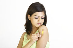 Young girl with band-aid royalty free stock photography
