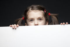 Young girl with banner on black Royalty Free Stock Photo