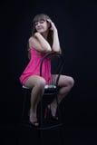 Young girl on a bar stool Stock Photos