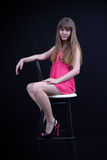 Young girl on a bar stool Royalty Free Stock Photography