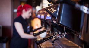 Young girl Barista prepares coffee in pub, bar Royalty Free Stock Photo