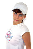 Young girl in baseball cap. Beautiful girl  in white T-shirt, isolated on white background Royalty Free Stock Images