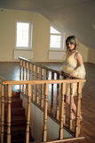 Young girl  based on carved wooden railing Royalty Free Stock Images