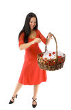 Young girl with basket of flowers isolated Royalty Free Stock Image