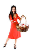 Young girl with basket of flowers isolated Stock Photo