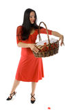 Young girl with basket of flowers isolated Stock Images