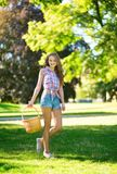 Young girl with basket going to have a picnic Royalty Free Stock Images