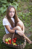 Young girl with basket of vegetables. Garden. Stock Photography