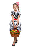 Young girl with a basket of vegetables Royalty Free Stock Photos