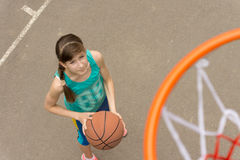 Young girl on a basketball court viewed from above Stock Photo