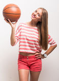 Young girl with basketball Stock Images
