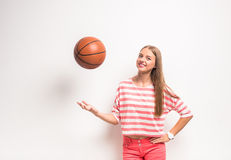 Young girl with basketball Royalty Free Stock Image