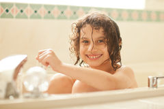 Young girl in a bath tub Stock Photo