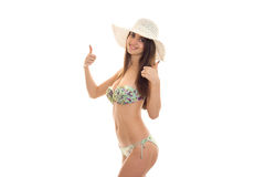 A young girl in a bathing suit and hat worth turning sideways and shows the class Stock Photo