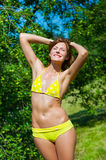 The young girl in a bathing suit sunbathes. In park Royalty Free Stock Image
