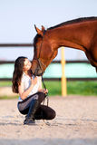 Young girl and bay horse - kiss Royalty Free Stock Images