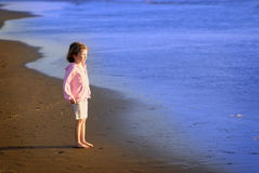 Young Girl on Beach Stock Images