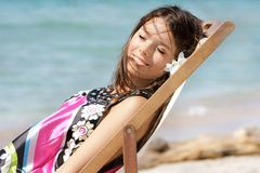 Young girl on beach Stock Image