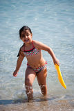 Young girl at the beach. A young girl playing at the beach Stock Image