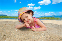 Young girl at the beach. Playing in the sand Stock Photos