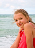 Young girl on the beach Royalty Free Stock Photos