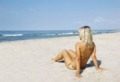 Young girl on beach. Young pretty girl on beach Royalty Free Stock Images