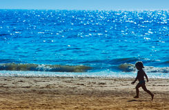 Young girl on the beach Royalty Free Stock Images