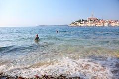 Young girl on beach Stock Photos