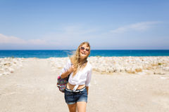 Young girl on the beach Royalty Free Stock Image