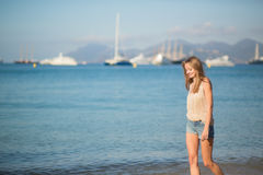 Young girl on the beach in Cannes Stock Image