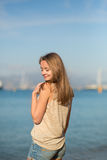 Young girl on the beach in Cannes Stock Photos
