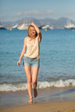 Young girl on the beach in Cannes Royalty Free Stock Photos