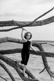 Young girl at the beach in driftwood branches Royalty Free Stock Images