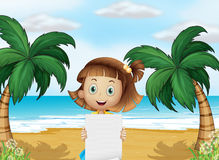 A young girl at the beach with an empty paper Royalty Free Stock Photo