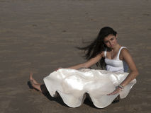 Young girl on beach with giant shell Royalty Free Stock Photos