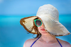 Young girl on the beach in green glasses Stock Images