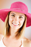Young girl with beach hat Stock Photos