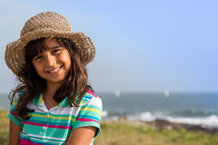Young girl at beach with hat Stock Photo