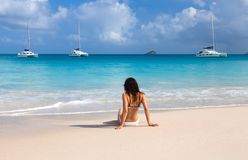 Young girl on the beach of Seychelles Stock Image