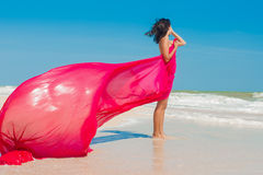 Young girl on the beach in the summer Stock Photography