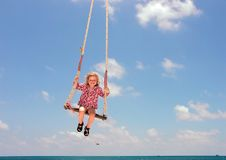 Young Girl on Beach Swing Royalty Free Stock Photography