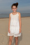 Young girl at beach with white dress royalty free stock image