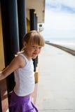 Young girl on beachside walkway Royalty Free Stock Photography