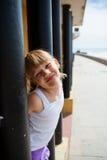 Young girl on beachside walkway Royalty Free Stock Photos