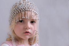Young girl with beaded hat. Portrait of a pretty, blond girl wearing a stylish beaded hat Stock Photos