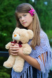 Young girl with bear Stock Images