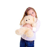 Young girl with bear. On white background Royalty Free Stock Photography