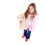 Young girl with bear. On white background Royalty Free Stock Image