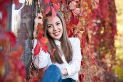 Young girl in beautiful autumn park, concept autumn. Autumn girl playing in city park stock photography